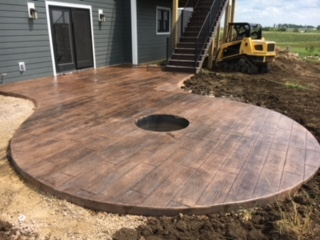 Poured and stamped concrete patio area with fire pit
