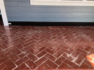Poured concrete stamped to look like red brick