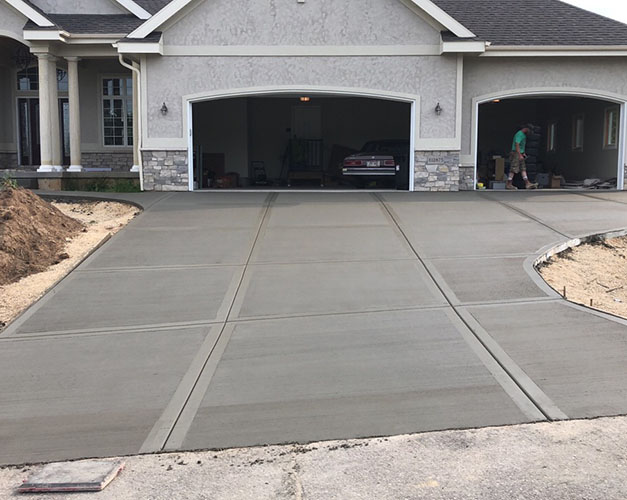 Freshly poured and stamped concrete driveway